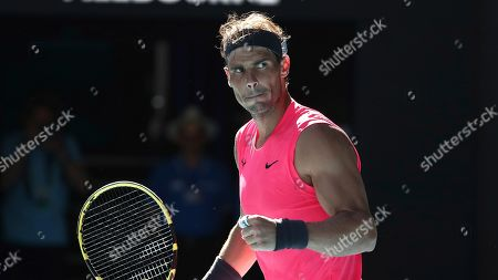 Spain's Rafael Nadal reacts after defeating compatriot Pablo Carreno Busta during their third round singles match at the Australian Open tennis championship in Melbourne, Australia