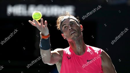 Spain's Rafael Nadal serves to compatriot Pablo Carreno Busta during their third round singles match at the Australian Open tennis championship in Melbourne, Australia