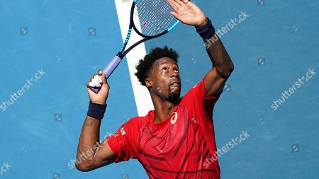 Gael Monfils of France serves to Ernests Gulbis of Latvia during their third round singles match at the Australian Open tennis championship in Melbourne, Australia