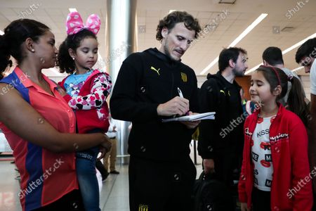 Stock Picture of Penarol coach Diego Forlan signs autographs upon arrival at Carrasco International Airport in Montevideo, Uruguay, 27 January 2020. The Uruguayan Penarol, directed by former soccer player Diego Forlan, returned to Montevideo on Monday after the preseason mini-tour he made in Los Angeles (United States) and is already thinking about the official presentation, which will take place this Friday before the Argentine Belgrano.