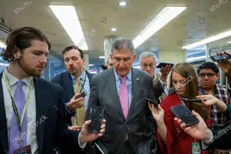 Stock Image of Democratic Senator from West Virginia Joe Manchin (C) speaks to the media before the start of the second week of the impeachment trial of US President Donald J. Trump in the Senate at the US Capitol in Washington, DC, USA, 27 January 2020. President Trump's defense team will continue to make their case during their second day of opening arguments in the impeachment trial of US President Donald J. Trump.
