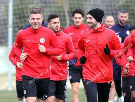 Lukas Podolski of Germany, left, smiles as he trains with his new soccer team Antalyaspor in Antalya, Turkey
