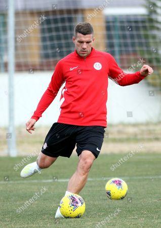 Lukas Podolski, of Germany, trains with his new soccer team Antalyaspor, in Antalya, Turkey