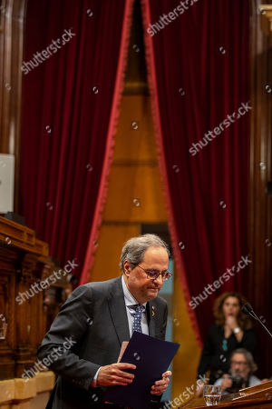 Catalan President Joaquim Torra walks after delivering a speech the Parliament of Catalonia in Barcelona, Spain. The Catalan regional parliament is leaving the president of the prosperous and troubled northeastern region without his lawmaker's seat because he disobeyed Spain's strict rules on election propaganda. Monday's move is likely to fuel anger among die-hard pro-independence supporters, who see behind Monday's decision by the electoral board of Catalonia's parliament yet another grievance from Spanish judicial decisions