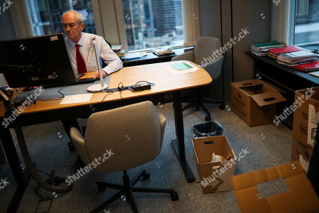 British European Parliament member and leader of Labour Party delegation Richard Corbett works on his computer as he packs some of his belongings at his office at the European Parliament in Brussels, . The U.K. is due to leave the EU on Friday, the first nation in the bloc to do so. It then enters an 11-month transition period in which Britain will continue to follow the bloc's rules while the two sides work out new deals on trade, security and other areas