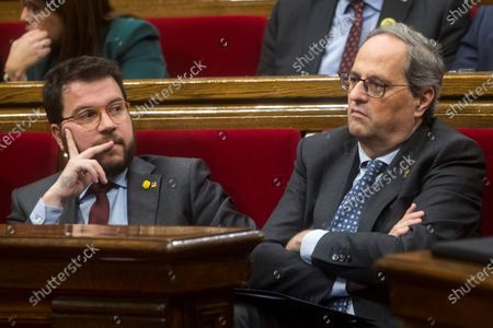 Catalan regional President Joaquim Torra (R) reacts next to vice President Pere Aragones (L) during a Catalan Parliament plenary session in Barcelona, Catalonia, north eastern Spain, 27 January 2020. The Catalan Regional Parliament withdrew Torra as a member of the Catalan lower house following the Spanish National Electoral Commission (JEC) ruling on 03 January 2020 to dismiss Catalan President Joaquim Torra, who refused to remove yellow ribbons from public buildings before the Spain general elections on 28 April.
