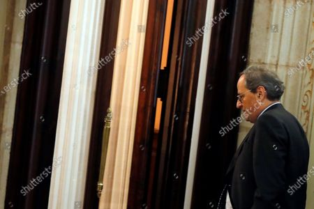 Catalan regional President Joaquim Torra arrives at a Catalan Parliament plenary session in Barcelona, Catalonia, north eastern Spain, 27 January 2020. The Catalan Regional Parliament withdrew Torra as a member of the Catalan lower house following the Spanish National Electoral Commission (JEC) ruling on 03 January 2020 to dismiss Catalan President Joaquim Torra, who refused to remove yellow ribbons from public buildings before the Spain general elections on 28 April.