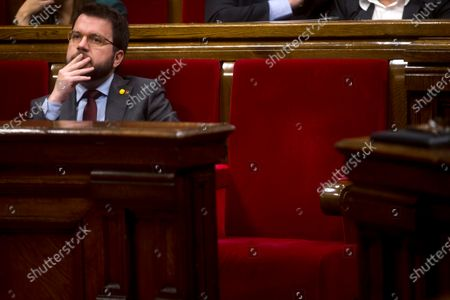 Catalan vice President Pere Aragones (L) reacts next to Catalan regional President Quim Torra's empty seat during a Catalan Parliament plenary session in Barcelona, Catalonia, north eastern Spain, 27 January 2020. The Catalan Regional Parliament withdrew Torra as a member of the Catalan lower house following the Spanish National Electoral Commission (JEC) ruling on 03 January 2020 to dismiss Catalan President Joaquim Torra, who refused to remove yellow ribbons from public buildings before the Spain general elections on 28 April.