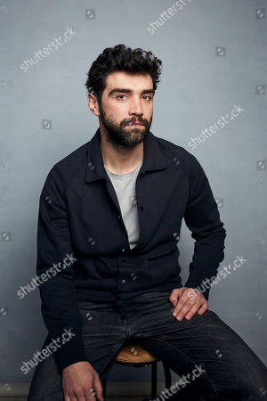 """Stock Photo of Alec Secareanu poses for a portrait to promote the film """"Amulet"""" at the Music Lodge during the Sundance Film Festival, in Park City, Utah"""