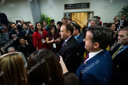 Stock Photo of Lee Zeldin, John Ratcliffe, Jim Jordan. Rep. Lee Zeldin, R-N.Y., from center to right, with Rep. John Ratcliffe, R-Texas and Rep. Jim Jordan, R-Ohio, speaks to reporters at the Capitol in Washington, during the impeachment trial of President Donald Trump on charges of abuse of power and obstruction of Congress