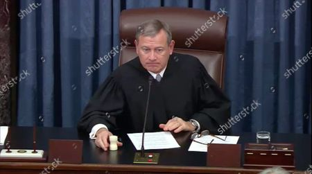 In this image from United States Senate television, Chief Justice of the US John G Roberts Jnr, Jr. calls a recess during the impeachment trial of US President Donald Trump in the US Senate in the US Capitol