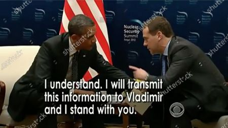 In this image from United States Senate television, US President Barack Obama speaks with Prime Minister Dmitry Medvedev of Russia in this graphic used by Eric Herschmann, counsel to the President as he makes his presentation during the impeachment trial of US President Trump in the US Senate in the US Capitol