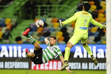 Sporting player Sebastian Coates (L) attempts to score against Maritimo goalkeeper Amir Abedzadeh during the Portuguese First League soccer match at Alvalade XXI Stadium in Lisbon, Portugal, 27 of January 2020.