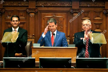 Brian Kemp, Geoff Duncan, David Ralston. Gov. Brian Kemp, center, is flanked by House Speaker David Ralston, R-Blue Ridge, right, and Lt. Gov. Geoff Duncan as he salutes former U.S. Senator Johnny Isakson, R-Ga., during the State of the State address before a joint session of the Georgia General Assembly in Atlanta. House Bill 757 passed Monday, Jan. 27, out of a House subcommittee. GOP Gov. Brian Kemp has threatened a veto