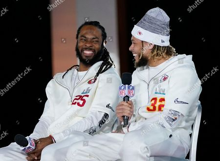 Stock Picture of San Francisco 49ers' Richard Sherman, left, and Kansas City Chiefs' Tyrann Mathieu chat during Opening Night for the NFL Super Bowl 54 football game, at Marlins Park in Miami