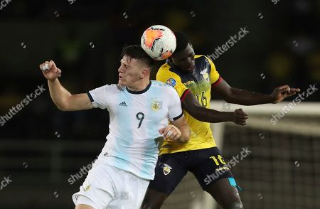 Stock Image of Adolfo Gaich, Sergio Quintero. Argentina's Adolfo Gaich, left, and Ecuador's Sergio Quintero, jump for a header during a South America Olympic qualifying U23 soccer match at the Hernan Ramirez Villegas stadium in Pereira, Colombia