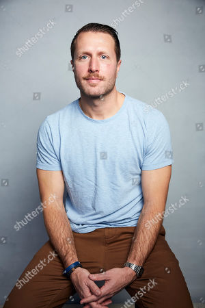 """Matthew Heineman poses for a portrait to promote """"The Trade"""" at the Music Lodge during the Sundance Film Festival, in Park City, Utah"""