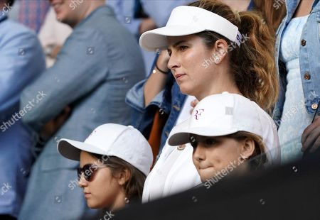 Mirka Federer with her twin daughters Charlene and Mila as they watch Roger following his quarterfinal win over Tennys Sandgren of the U.S. at the Australian Open tennis championship in Melbourne, Australia