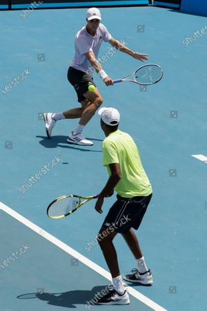 Joe Salisbury (L) of Britain and Rajeev Ram (R) of USA in action during their men's doubles round four match against Jan-Lennard Struff of Germany and Henri Kontinen of Finland at the Australian Open Grand Slam tennis tournament in Melbourne, Australia, 28 January 2020.
