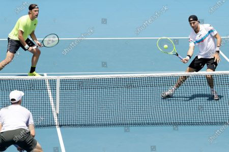 Jan-Lennard Struff (L) of Germany and Henri Kontinen (R) of Finland in action during their men's doubles round four match against Rajeev Ram of USA and Joe Salisbury of Britain at the Australian Open Grand Slam tennis tournament in Melbourne, Australia, 28 January 2020.
