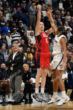 Connecticut head coach Geno Auriemma watches a shot attempt by United States' Breanna Stewart, center, as Connecticut's Megan Walker, right, defends, in the first half of an exhibition basketball game, in Hartford, Conn