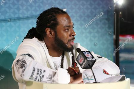 San Francisco 49ers cornerback Richard Sherman speaks to the media during Opening Night for the NFL Super Bowl 54 football game, in Miami