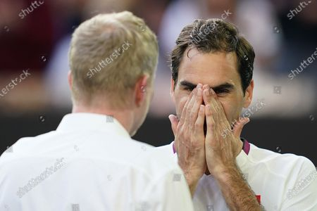 Stock Image of Roger Federer (R) of Switzerland speaks to Jim Courier (L) after wining his fifth round match against Tennys Sandgren of the USA at the Australian Open tennis tournament at Melbourne Park in Melbourne, Australia, 28 January 2020.