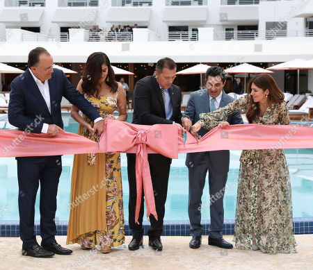 Stock Photo of Hotel owners Paul and Dayssi Kanavos, General Manager Sase Gjorsovski, and hotel owners Diego and Gisela Lowenstein at the grand re-opening of The Ritz-Carlton, South Beach on in Miami