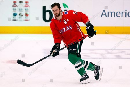 Dallas Stars center Tyler Seguin skates during warm-ups wearing a baseball style jersey during warm-ups on Texas Rangers Nigh tprior to an NHL hockey game against the Tampa Bay Lightning in Dallas, . Dallas won, 3-2 in overtime