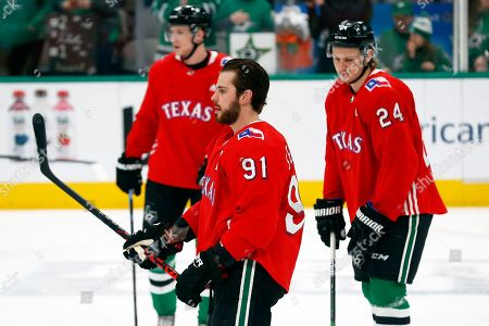 Dallas Stars center Tyler Seguin and teammates wear baseball style jerseys during warm-ups on Texas Rangers Night prior to an NHL hockey game against the Tampa Bay Lightning in Dallas, . Dallas won, 3-2 in overtime
