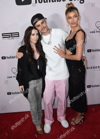 "Pattie Mallette, Justin Bieber, Hailey Baldwin. From left, Pattie Mallette, Justin Bieber and Hailey Baldwin arrive at the Los Angeles premiere of ""Justin Bieber: Seasons"" on"
