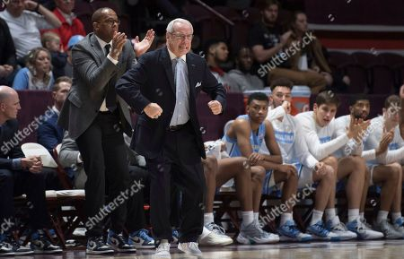 North Carolina head basketball coach Roy Williams gets intense during game against Virginia Tech during the first half of an NCAA college basketball game in Blacksburg, Va