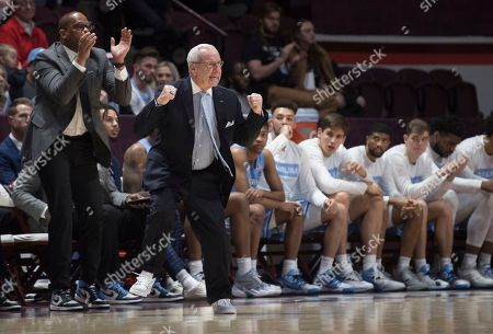 North Carolina head basketball coach Roy Williams gets his team fired up against Virginia Tech during the first half of an NCAA college basketball game in Blacksburg, Va