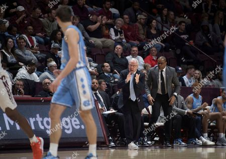 North Carolina head basketball coach Roy Williams cheers on his team against Virginia Tech during the first half of an NCAA college basketball game in Blacksburg, Va