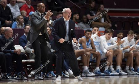 North Carolina head basketball coach Roy Williams reacts to his teams play against Virginia Tech during the first half of an NCAA college basketball game in Blacksburg, Va
