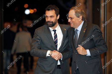 Catalan regional President, Quim Torra (R) greets Catalan regional Speaker Roger Torrent (L) at the end of the inquiry commission on the implementation of Spanish Constitution's article 155 at regional Parliament in Barcelona, Spain, 28 January 2020. The implementation of the article by the central government led to the dismissals of former Catalan ministers for their involvement in the pro-independence process in 2017. Imprisoned former Catalan Deputy President Oriol Junqueras and former regional ministers Jordi Turull, Josep Rull, Raul Romeva, Dolors Bassa and Joaquim Form left the jail to attend the inquiry. EFE/ALEJANDRO GARCIA