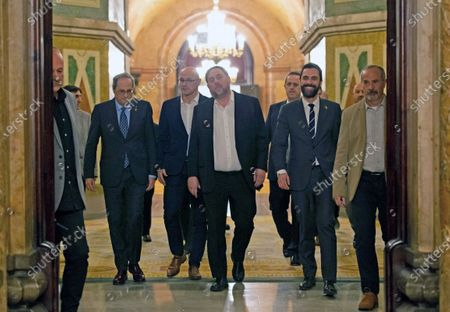 Stock Picture of Catalan regional President, Quim Torra (2-L); Catalan regional Speaker Roger Torrent (2-R); Oriol Junqueras (C), imprisoned former Catalan regional Deputy President; Raul Romeva (3-L) and Joaquim Forn (3-R), imprisoned former regional ministers, leave at the end of the inquiry commission on the implementation of Spanish Constitution's article 155 at regional Parliament in Barcelona, Spain, 28 January 2020. The implementation of the article by the central government led to the dismissals of former Catalan ministers for their involvement in the pro-independence process in 2017. Imprisoned former Catalan Deputy President Oriol Junqueras and former regional ministers Jordi Turull, Josep Rull, Raul Romeva, Dolors Bassa and Joaquim Form left the jail to attend the inquiry.
