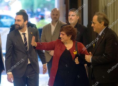 Dolors Bassa (C), imprisoned former Catalan regional minister, waves as she is welcomed by Catalan regional President, Quim Torra (R), and Catalan Parliament's Speaker, Roger Torrent (L), upon her arrival to the regional Chamber to appear before the inquiry commission on the implementation of Spanish Constitution's article 155 in Barcelona, Spain, 28 January 2020. The implementation of the article by the central government led to the dismissals of former Catalan ministers for their involvement in the pro-independence process in 2017. Imprisoned former Catalan Deputy President Oriol Junqueras and former regional ministers Jordi Turull, Josep Rull, Raul Romeva, Dolors Bassa and Joaquim Form left the jail to attend the inquiry.