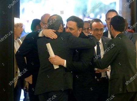 Oriol Junqueras (C), imprisoned former Catalan regional Deputy President, is welcomed by Catalan regional President, Quim Torra (L), upon his arrival to the regional Chamber to appear before the inquiry commission on the implementation of Spanish Constitution's article 155 in Barcelona, Spain, 28 January 2020. The implementation of the article by the central government led to the dismissals of former Catalan ministers for their involvement in the pro-independence process in 2017. Imprisoned former Catalan Deputy President Oriol Junqueras and former regional ministers Jordi Turull, Josep Rull, Raul Romeva, Dolors Bassa and Joaquim Form left the jail to attend the inquiry.