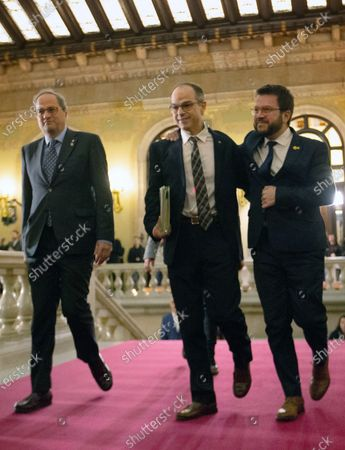 Jordi Turull (C), imprisoned former Catalan regional minister, waves as she is welcomed by Catalan regional President, Quim Torra (L), and Catalan Deputy President, Pere Aragones (R), upon his arrival to the regional Chamber to appear before the inquiry commission on the implementation of Spanish Constitution's article 155 in Barcelona, Spain, 28 January 2020. The implementation of the article by the central government led to the dismissals of former Catalan ministers for their involvement in the pro-independence process in 2017. Imprisoned former Catalan Deputy President Oriol Junqueras and former regional ministers Jordi Turull, Josep Rull, Raul Romeva, Dolors Bassa and Joaquim Form left the jail to attend the inquiry.