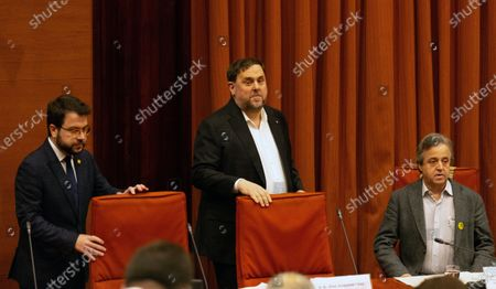 Oriol Junqueras (C), imprisoned former Catalan regional Deputy President; Catalan regional Deputy President, Pere Aragones (L), and inquiry's President, Antoni Morral (R), arrive to the regional Chamber to appear before the inquiry commission on the implementation of Spanish Constitution's article 155 in Barcelona, Spain, 28 January 2020. The implementation of the article by the central government led to the dismissals of former Catalan ministers for their involvement in the pro-independence process in 2017. Imprisoned former Catalan Deputy President Oriol Junqueras and former regional ministers Jordi Turull, Josep Rull, Raul Romeva, Dolors Bassa and Joaquim Form left the jail to attend the inquiry.