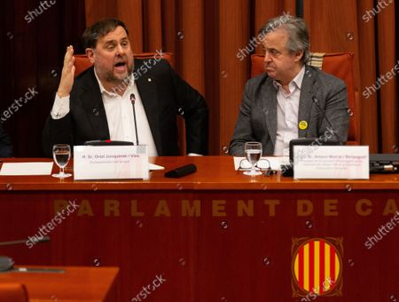 Oriol Junqueras (L), imprisoned former Catalan regional Deputy President, delivers a speech next to inquiry commission's President, Antoni Morral (R), during the inquiry commission on the implementation of Spanish Constitution's article 155 at regional Parliament in Barcelona, Spain, 28 January 2020. The implementation of the article by the central government led to the dismissals of former Catalan ministers for their involvement in the pro-independence process in 2017. Imprisoned former Catalan Deputy President Oriol Junqueras and former regional ministers Jordi Turull, Josep Rull, Raul Romeva, Dolors Bassa and Joaquim Form left the jail to attend the inquiry.
