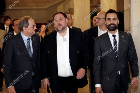 Catalan regional President, Quim Torra (L), Catalan regional Speaker Roger Torrent (R), and Oriol Junqueras (C), imprisoned former Catalan regional Deputy President, leave at the end of the inquiry commission on the implementation of Spanish Constitution's article 155 at regional Parliament in Barcelona, Spain, 28 January 2020. The implementation of the article by the central government led to the dismissals of former Catalan ministers for their involvement in the pro-independence process in 2017. Imprisoned former Catalan Deputy President Oriol Junqueras and former regional ministers Jordi Turull, Josep Rull, Raul Romeva, Dolors Bassa and Joaquim Form left the jail to attend the inquiry.