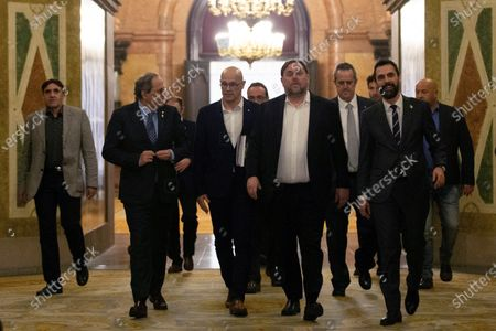 Catalan regional President, Quim Torra (2-L); Catalan regional Speaker Roger Torrent (R); Oriol Junqueras (C), imprisoned former Catalan regional Deputy President; Raul Romeva (3-L) and Joaquim Forn (2-R), imprisoned former regional ministers, leave at the end of the inquiry commission on the implementation of Spanish Constitution's article 155 at regional Parliament in Barcelona, Spain, 28 January 2020. The implementation of the article by the central government led to the dismissals of former Catalan ministers for their involvement in the pro-independence process in 2017. Imprisoned former Catalan Deputy President Oriol Junqueras and former regional ministers Jordi Turull, Josep Rull, Raul Romeva, Dolors Bassa and Joaquim Form left the jail to attend the inquiry.