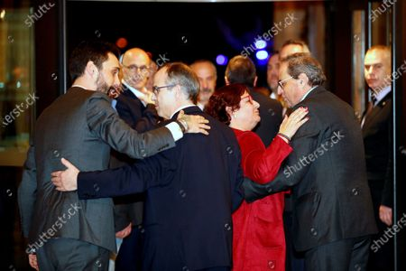 Stock Image of Catalan regional President, Quim Torra (R), and Catalan regional Speaker Roger Torrent (L) greet Dolors Bassa (2-R) and Jordi Turull (2-L), imprisoned former regional ministers, after the inquiry commission on the implementation of Spanish Constitution's article 155 at regional Parliament in Barcelona, Spain, 28 January 2020. The implementation of the article by the central government led to the dismissals of former Catalan ministers for their involvement in the pro-independence process in 2017. Imprisoned former Catalan Deputy President Oriol Junqueras and former regional ministers Jordi Turull, Josep Rull, Raul Romeva, Dolors Bassa and Joaquim Form left the jail to attend the inquiry.
