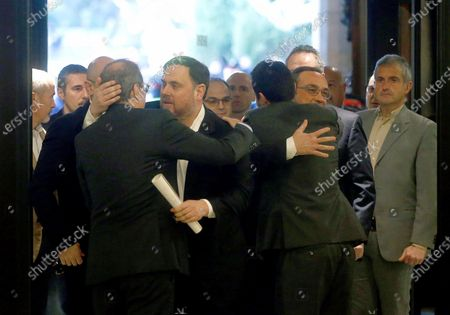 Oriol Junqueras (2-L), imprisoned former Catalan regional Deputy President, is welcomed by Catalan regional President, Quim Torra (L), upon his arrival to the regional Chamber to appear before the inquiry commission on the implementation of Spanish Constitution's article 155 in Barcelona, Spain, 28 January 2020. The implementation of the article by the central government led to the dismissals of former Catalan ministers for their involvement in the pro-independence process in 2017. Imprisoned former Catalan Deputy President Oriol Junqueras and former regional ministers Jordi Turull, Josep Rull, Raul Romeva, Dolors Bassa and Joaquim Form left the jail to attend the inquiry.