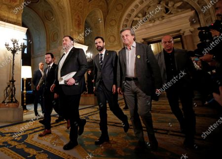 Stock Image of Oriol Junqueras (3-L), imprisoned former Catalan regional Deputy President, is welcomed by Catalan regional Deputy President, Pere Aragones (2-L) and regional Parliament Speaker, Roger Torrent (3-R), upon his arrival to the regional Chamber to appear before the inquiry commission on the implementation of Spanish Constitution's article 155 in Barcelona, Spain, 28 January 2020. The implementation of the article by the central government led to the dismissals of former Catalan ministers for their involvement in the pro-independence process in 2017. Imprisoned former Catalan Deputy President Oriol Junqueras and former regional ministers Jordi Turull, Josep Rull, Raul Romeva, Dolors Bassa and Joaquim Form left the jail to attend the inquiry.