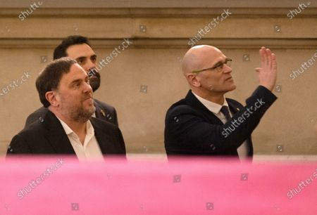 Oriol Junqueras (L), imprisoned former Catalan regional Deputy President, and Raul Romeva (R), imprisoned former regional minister, are welcomed by Catalan regional Speaker Roger Torrent (2-L), upon their arrival to the regional Chamber to appear before the inquiry commission on the implementation of Spanish Constitution's article 155 in Barcelona, Spain, 28 January 2020. The implementation of the article by the central government led to the dismissals of former Catalan ministers for their involvement in the pro-independence process in 2017. Imprisoned former Catalan Deputy President Oriol Junqueras and former regional ministers Jordi Turull, Josep Rull, Raul Romeva, Dolors Bassa and Joaquim Form left the jail to attend the inquiry.