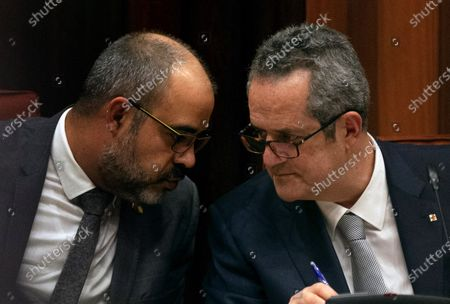 Stock Picture of Joaquim Forn (R), imprisoned former Catalan regional Home minister, and Miquel Buch, regional Home Minister, attend the inquiry commission on the implementation of Spanish Constitution's article 155 at regional Parliament in Barcelona, Spain, 28 January 2020. The implementation of the article by the central government led to the dismissals of former Catalan ministers for their involvement in the pro-independence process in 2017. Imprisoned former Catalan Deputy President Oriol Junqueras and former regional ministers Jordi Turull, Josep Rull, Raul Romeva, Dolors Bassa and Joaquim Form left the jail to attend the inquiry.