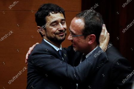 Josep Rull (R), imprisoned former Catalan regional minister, is greeted by Catalan regional Land minister, Damià Calvet, after the inquiry commission on the implementation of Spanish Constitution's article 155 at regional Parliament in Barcelona, Spain, 28 January 2020. The implementation of the article by the central government led to the dismissals of former Catalan ministers for their involvement in the pro-independence process in 2017. Imprisoned former Catalan Deputy President Oriol Junqueras and former regional ministers Jordi Turull, Josep Rull, Raul Romeva, Dolors Bassa, and Joaquim Form left the jail to attend the inquiry.